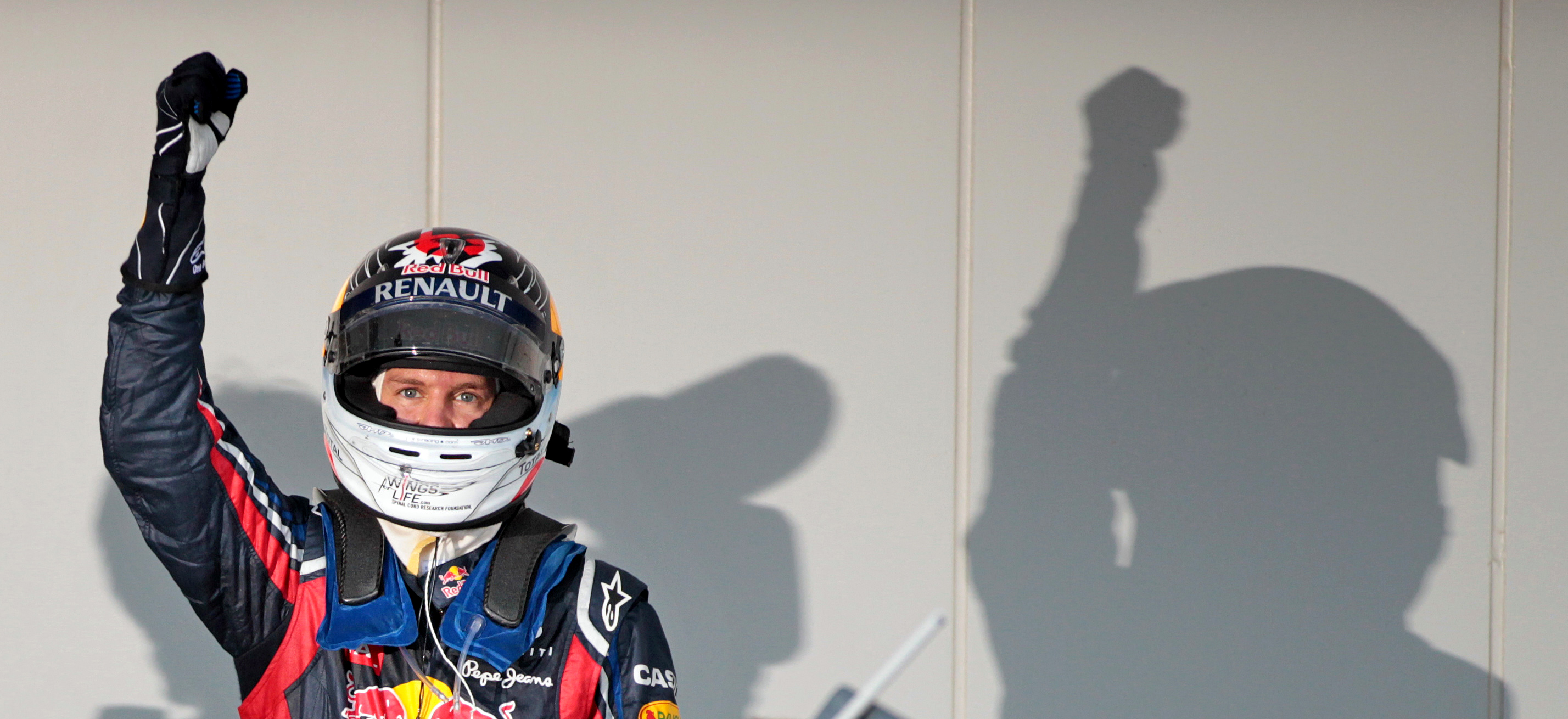 New Formula One champion German Sebastian Vettel of Red Bull cheers after the Japan Formula One Grand Prix at the Suzuka Circuit in Suzuka, Japan, 09 October 2011. Photo: Jan Woitas dpa